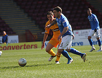 Jack Compton (nearest) being closed down by Ross Forbes in the Motherwell v St Johnstone Clydesdale Bank Scottish Premier League match played at Fir Park, Motherwell on 28.4.12.