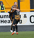 "Alloa""s Greig Spence (9) celebrates with Michael Doyle after he scores their first goal."