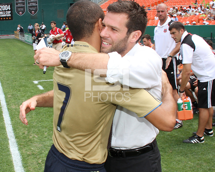 Ben Olsen of D.C. United greets Fred #7 of the Philadelphia Union during an MLS match at RFK Stadium on August 22 2010, in Washington DC. United won 2-0.