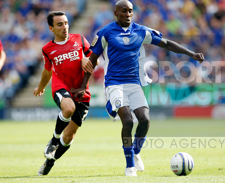 Leicester's Lloyd Dyer and Swansea's Leon Britton
