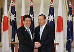AUSTRALIA, Canberra : Japanese Prime Minister Shinzo Abe (L) shakes hands with Australian Prime Minister Tony Abbott after signing the visitors book at Parliament House in Canberra on July 8, 2014. Defence ties are set to take centre stage when Australia plays host to Japanese Prime Minister Shinzo Abe this week, as the two countries look set to strengthen their relationship through annual leaders' meetings. AFP PHOTO / Mark GRAHAM