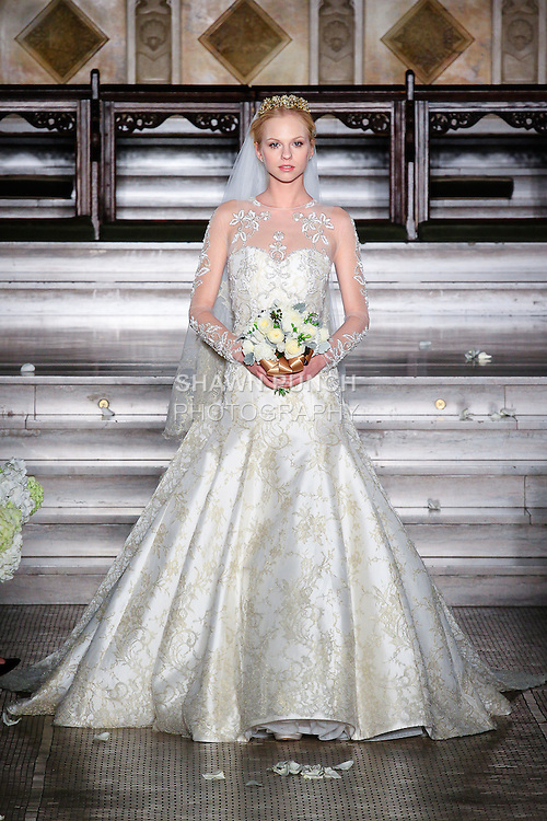 Model walks runway in a Yolima bridal gown from the Atelier Pronovias 2014 collection by Pronovias, at St. James' Church in New York City, on November 12, 2013.
