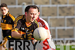 Dr Crokes Shane Myers gets his pass off under pressure from Rathmore's Mark Reen during the O'Donoghue Cup final in Fitzgerald Stadium on Sunday