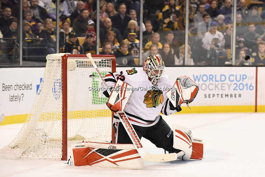 Thursday, March 3, 2016: Chicago Blackhawks goalie Scott Darling (33) lets the puck slip by during the first period at the National Hockey League game between the Chicago Blackhawks and the Boston Bruins, held at TD Garden, in Boston, Massachusetts. Eric Canha/CSM