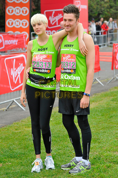 AGYNESS DEYN & HENRY HOLLAND.Virgin London Marathon, Blackheath, London, England..April 17th, 2011.full length green top black spandex legging vest top arm over shoulder .CAP/CAS.©Bob Cass/Capital Pictures.
