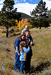 A family of five pause while hiking on a trail in Rocky Mtn Nat'l Park, CO.