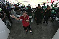 United States Men's National team fan tries to hang a banner while being guarded by Mexican police officers at Azteca stadium. The United States Men's National Team played Mexico in a CONCACAF World Cup Qualifier match at Azteca Stadium in, Mexico City, Mexico on Wednesday, August 12, 2009.