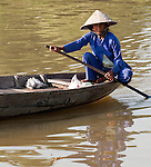 Vietnamese Boatwoman 01 - Vietnamese boat woman in a small boat on the Thu Bon River, Hoi An, Viet Nam