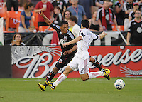 DC United midfielder Andy Najar (14) goes against Real Salt Lake defender Tony Beltran (2)   DC United and Real Salt Lake tied 0-0 at RFK Stadium, Wednesday  June 2  2010.
