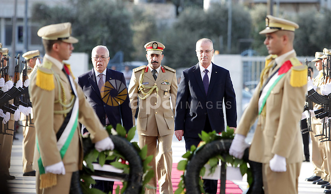 Palestinian Prime Minister Rami Hamdallah lays a wreath on the tomb of former leader Yasser Arafat on the first day of Eid al-Adha, in the West Bank city of Ramallah on September 24, 2015. Muslims across the world are celebrating the annual festival of Eid al-Adha, or the Festival of Sacrifice, which marks the end of the Hajj pilgrimage to Mecca and in commemoration of Prophet Abraham's readiness to sacrifice his son to show obedience to God. Photo by Prime Minister Office