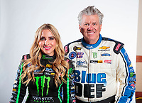 Feb 5, 2020; Pomona, CA, USA; NHRA top fuel driver Brittany Force (left) and father John Force pose for a portrait during NHRA Media Day at the Pomona Fairplex. Mandatory Credit: Mark J. Rebilas-USA TODAY Sports