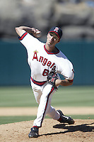 Scot Shields of the Los Angeles Angels pitches during a 2002 MLB season game at Angel Stadium, in Anaheim, California. (Larry Goren/Four Seam Images)