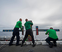111206-N-DR144-933 PACIFIC OCEAN (Dec. 6, 2011) Sailors assigned to Air Department's V-2 Division Visual Landing Aids shop practice rigging the Manually Operated Visual Landing Aids System (MOVLAS) during timed drills on the flight deck aboard Nimitz-class aircraft carrier USS Carl Vinson (CVN 70). Carl Vinson and Carrier Air Wing (CVW) 17 are currently underway on a Western Pacific deployment.  (U.S. Navy photo by Mass Communication Specialist 2nd Class James R. Evans/Released)