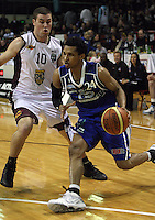 Saints import Mike Efevberha goes around Heat guard Karl Noyer during the National Basketball League match Wellington Saints and Harbour Heat at TSB Bank Arena, Wellington, New Zealand on Saturday 13 June 2009. Photo: Dave Lintott / lintottphoto.co.nz