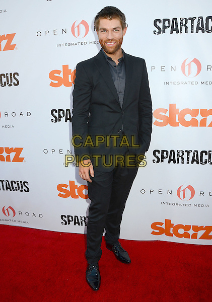 Liam McIntyre.Starz Celebrates Kirk Douglas and the Impact of Spartacus Then and Now held at the Academy of Television Arts & Sciences Goldenson Theater, North Hollywood, California, USA..May 31st, 2012.full length grey gray suit jacket shirt beard facial hair .CAP/ADM/BT.©Birdie Thompson/AdMedia/Capital Pictures.