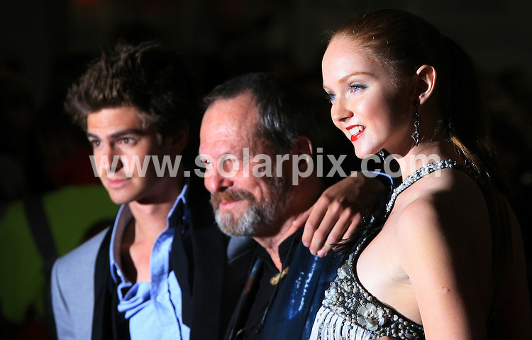 """**ALL ROUND PICTURES FROM SOLARPIX.COM**.**WORLDWIDE SYNDICATION RIGHTS**.The UK Premiere of """"The Imaginarium of Doctor Parnassus"""" at the Empire Cinema in Leicester Square, London on Tuesday 6 October 2009.This pic:  Andrew Garfield, Terry Gilliam and Lily Cole.JOB REF:  10074   LNJ     DATE:  07.10.09.**MUST CREDIT SOLARPIX.COM OR DOUBLE FEE WILL BE CHARGED**.**MUST NOTIFY SOLARPIX OF ONLINE USAGE**.**CALL US ON: +34 952 811 768 or LOW RATE FROM UK 0844 617 7637**"""