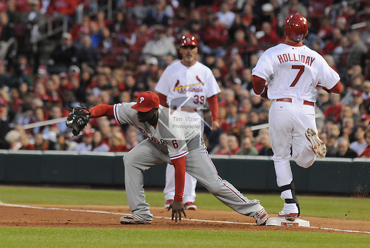17 May 2011                              Philadelphia Phillies first baseman Ryan Howard (6) catches the throw to first for the out on St. Louis Cardinals left fielder Matt Holliday (7) early in the game. The St. Louis Cardinals defeated the Philadelphia Phillies 2-1 on Tuesday May 17, 2011 in the second game of a two-game series at Busch Stadium in downtown St. Louis.