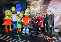 """New York - DECEMBER 17: Nancy Cartwright, Pamela Hayden, Stephanie Gillis and Mike Scully, along with costumed characters, participate in the ceremonial lighting of the Empire State Building as they attend the Empire State Building Celebration of the 30th Anniversary of FOX's """"The Simpsons"""" on December 17, 2018 in New York City.  (Photo by Anthony Behar/FOX/PictureGroup)"""