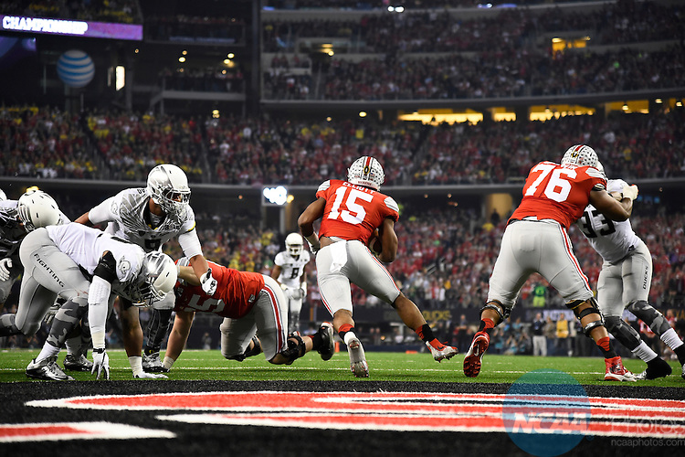 12 JAN 2015:  Ezekiel Elliott (15) of the Ohio State University rushes against the University of Oregon during the College Football Playoff National Championship held at AT&T Stadium in Arlington, TX.  Ohio State defeated Oregon 42-20 for the national title.  Jamie Schwaberow/NCAA Photos