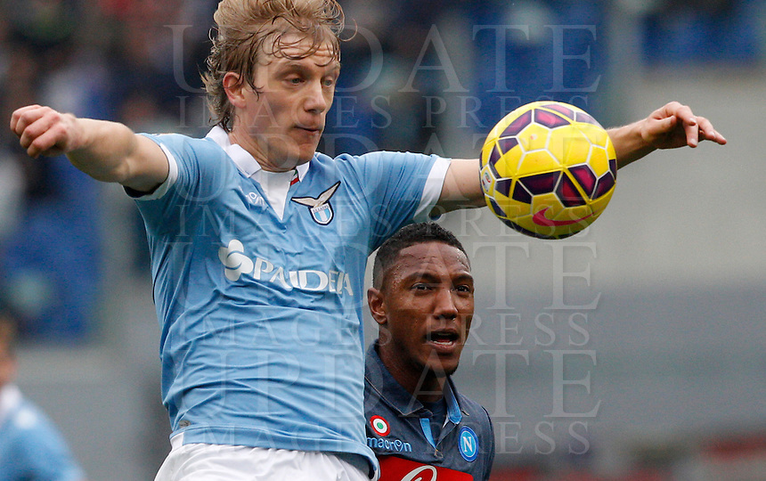 Calcio, Serie A: Lazio vs Napoli. Roma, stadio Olimpico, 18 gennaio 2015.<br /> Lazio&rsquo;s Dusan Basta and Napoli&rsquo;s Jonathan De Guzman, right, jump for the ball during the Italian Serie A football match between Lazio and Napoli at Rome's Olympic stadium, 18 January 2015.<br /> UPDATE IMAGES PRESS/Riccardo De Luca