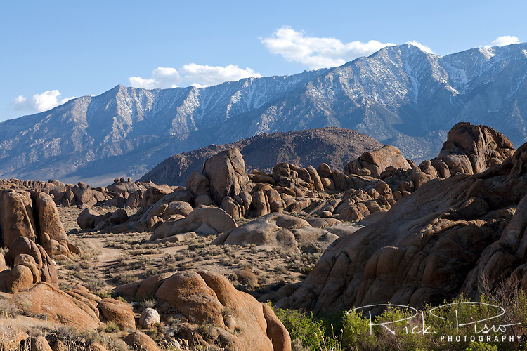 "Alabama Hills near Lone Pine, California. Since the 1920's film makers have been using the Alabama Hills as a backdrop for their movies. In the early days of motion pictures films such as ""Gunga Din"", ""How the West Was Won"", and ""Yellow Sky"" were filmed at a site within the recreation area known as ""Movie Flats. More recently movies such as ""Tremors"", ""Star Trek Generations,"" ""Gladiator"", ""Iron Man"", and ""Django Unchained"" were shot in the Alabama Hills."