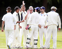 Wembley players celebrate capturing a North London wicket during the Middlesex County Cricket League Division Three game between North London and Wembley at Park Road, Crouch End on Sat Aug 2, 2014