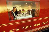 An American couple enjoying formal dinner in the Royal Scotsman at Spean Bridge.
