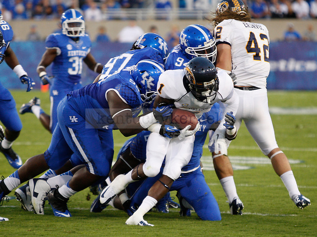 Kent State Junior wide receiver Dri Archer is tackled by Kentucky players at Commonwealth Stadium on Saturday, Sept. 8, 2012. Photo by Scott Hannigan | Staff