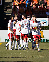New York Red Bulls players Sinisa Ubiparipovic (8), Dane Richards (19), John Wolyniec (15), Juan Pablo Angel (9), and Luke Sassano (32) celebrate a goal.  New York Red Bulls defeated Houston Dynamo 3-0 for an aggregate  score of 4-1 over Houston Dynamo   at Robertson Stadium in Houston, TX on November 9, 2008 in the second leg of the Western Conference semifinals.  Photo by Wendy Larsen/isiphotos.com
