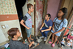 "Larren Jo ""LJ"" Bacilio, a teacher in the Alternative Learning System of the Kapatiran-Kaunlaran Foundation (KKFI), talks with some of his students at their home in the Tondo neighborhood of Manila, Philippines. <br /> <br /> KKFI is supported by United Methodist Women."