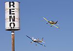 George Ford from Longview WA.,bottom races Benjam Fouts from Kailua KonaHI. in the Sport Champion class during the National Championship Air Races at the Reno-Stead Airfield Sunday, Sept. 20, 2015.