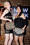 Model poses with designer Mary Lai (right), holding MaryLai handbags during the inaugural Wear New York Fashion Week presentation at 393 Broadway on June 27, 2013.