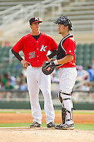 Kannapolis Intimidators catcher Zachary Fisher (13) visits the mound to talk to his pitcher Jake Cose (35) during the game against the Delmarva Shorebirds at CMC-Northeast Stadium on April 17, 2013 in Kannapolis, North Carolina.  The Shorebirds defeated the Intimidators 9-4.  (Brian Westerholt/Four Seam Images)