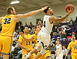 SIOUX FALLS, SD - DECEMBER 7: Trevon Evans #4 from the University of Sioux Falls takes the ball to the basket past Max Keefe #32 from Concordia St. Paul during their game Friday night at the Stewart Center in Sioux Falls, SD. (Photo by Dave Eggen/Inertia)