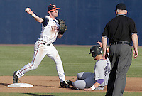 Virginia infielder Branden Cogswell (7) gets the double play at second over James Madison first baseman Matt Tenaglia (20) during the game against James Madison University Tuesday in Charlottesville, VA.  Photo/The Daily Progress/Andrew Shurtleff