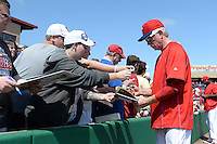 Philadelphia Phillies coach Mike Schmidt (20) signs autographs before an exhibition game against the University of Tampa on March 1, 2015 at Bright House Field in Clearwater, Florida.  University of Tampa defeated Philadelphia 6-2.  (Mike Janes/Four Seam Images)