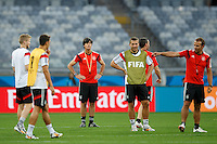 Germany manager Joachim Low watches his players Lukas Podolski , Andre Schurrle and Mesut Ozil