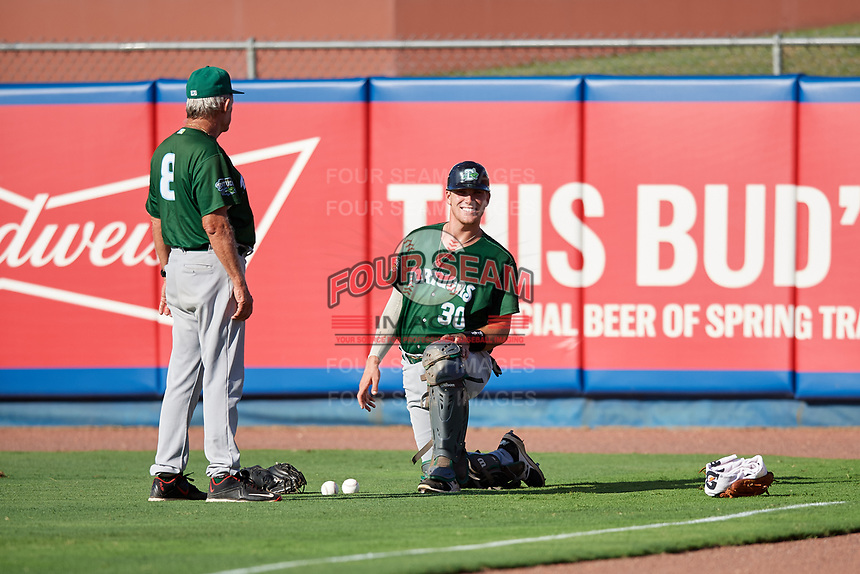Daytona Tortugas catcher Tyler Stephenson (30) with pitching coach Tom Brown (8) before a game against the St. Lucie Mets on August 3, 2018 at First Data Field in Port St. Lucie, Florida.  Daytona defeated St. Lucie 3-2.  (Mike Janes/Four Seam Images)