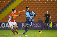 Anthony Stewart of Wycombe Wanderers & Michael Cain of Blackpool during the The Checkatrade Trophy match between Blackpool and Wycombe Wanderers at Bloomfield Road, Blackpool, England on 10 January 2017. Photo by Andy Rowland / PRiME Media Images.