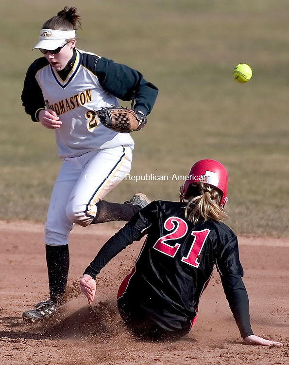 LITCHFIELD, CT- 10 APRIL 07- 041007JT04- <br /> Thomaston's Sara Sanford misses the ball as Wamogo's Katrina Earl safely slides to second base at Tuesday's game at Wamogo.<br /> Josalee Thrift Republican-American