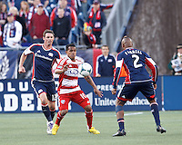 FC Dallas midfielder David Ferreira (10) attempts to control the ball as New England Revolution substitute midfielder Andy Dorman (12) closes..  In a Major League Soccer (MLS) match, FC Dallas (red) defeated the New England Revolution (blue), 1-0, at Gillette Stadium on March 30, 2013.