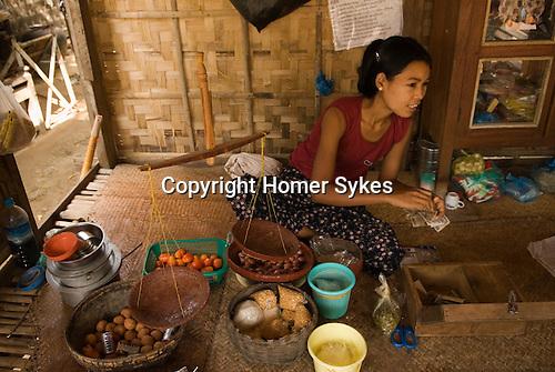Woman in village shop Bagan Pagan Burma Myanmar 2006