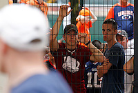 Virginia  and Brigham Young fans wait outside the stadium to be let back in after lightning caused a 2-hour delay during the first half of the game in Charlottesville, Va. Virginia defeated Brigham Young 19-16. Photo/Andrew Shurtleff