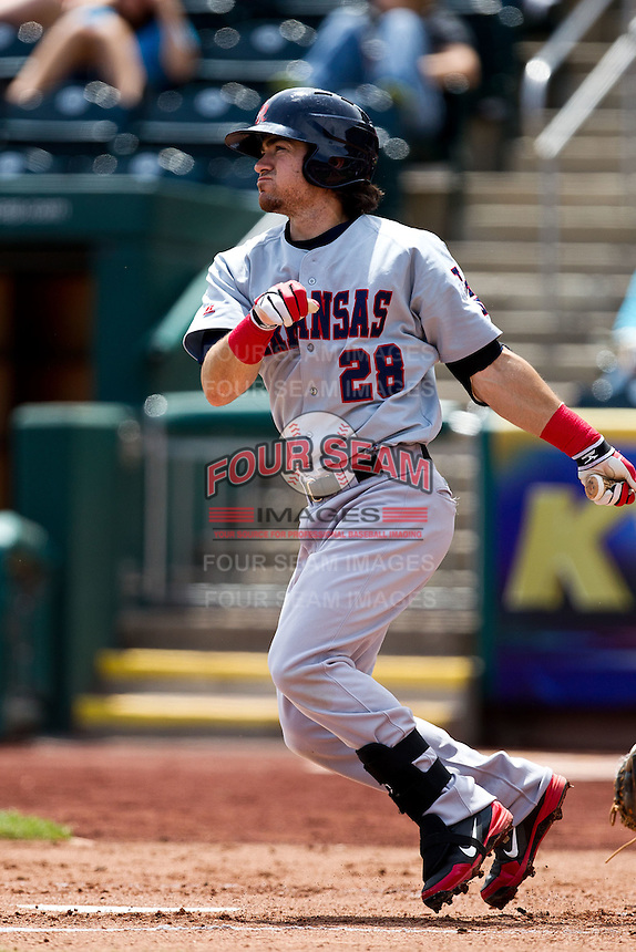 Adam Heether (28) of the Arkansas Travelers follows through his swing during a game against the Springfield Cardinals at Hammons Field on May 8, 2012 in Springfield, Missouri. (David Welker/ Four Seam Images).