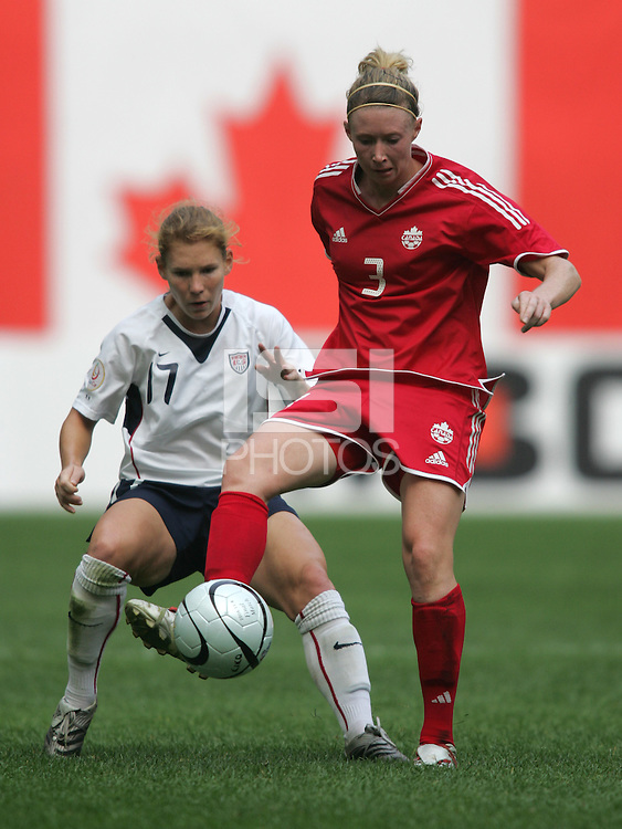 Nov 4, 2006: Seoul, South Korea:  Canadian midfielder (3) Melanie Booth plays the ball away from the defense of USWNT player (17) Lori Chalupny while playing in the Peace Queen Cup final at Seoul World Cup Stadium. The United States defeated Canada, 1-0.