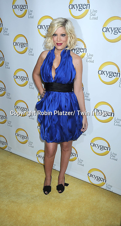Tori Spelling  in blue Marchesa dress attending the Oxygen Upfront on April 4, 2011 at Gotham Hall in New York City.