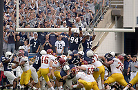 27 September 2003: Rhys Lloyds (16)'s field goal sails just over the fingertips of Penn State's Derek Cameron Wake (94) to seal a minnesota win.  Minnesota defeated Penn State 20-14  at Beaver Stadium in State College, PA.  Credit: Photo by Randy Litzinger
