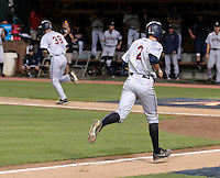 Virginia infielder John La Prise (2) makes his way to home p[late after Virginia outfielder Mike Papi (38) is walked in the third inning during an NCAA college baseball regional tournament game against Arkansas in Charlottesville, VA., Sunday, June 1, 2014. (Photo/Andrew Shurtleff)