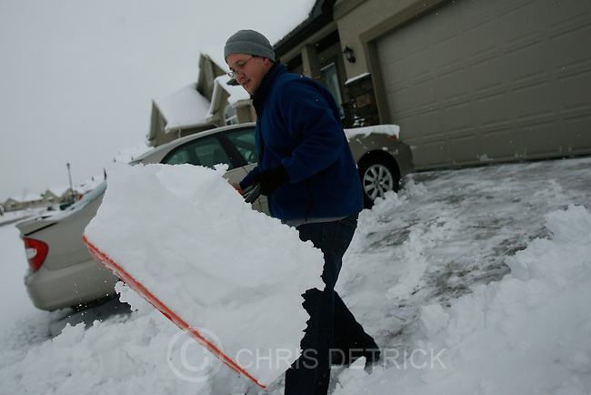 Daniel Elmer shovels snow from his driveway in Lehi Thursday December 25, 2008.  Lehi is expected to receive 3 to 5 inches of new snow Thursday night. ...Chris Detrick/The Salt Lake Tribune..