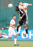 Ange N'Silu #9 of D.C. United loses a header to Luke Sassano #32 of New York Red Bulls during a U.S. Open Cup match at RFK Stadium on May 20 2009, in Washington D.C. D.C. United won 5-3.